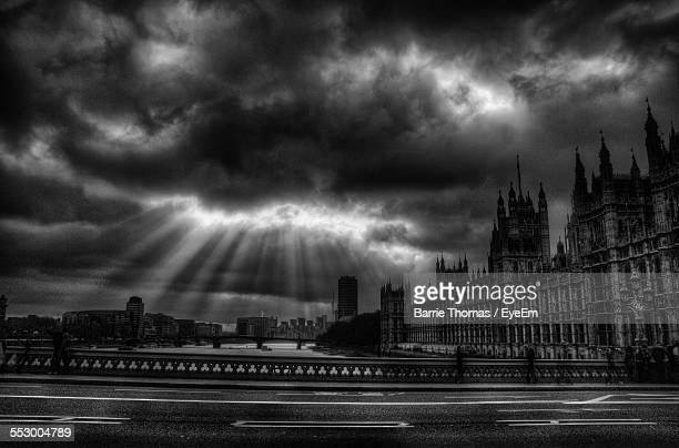 Houses Of Parliament Against Cloudy Sky At Dusk