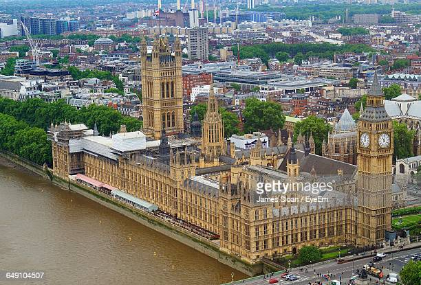 Houses Of Parliament And Big Ben By Thames River In City