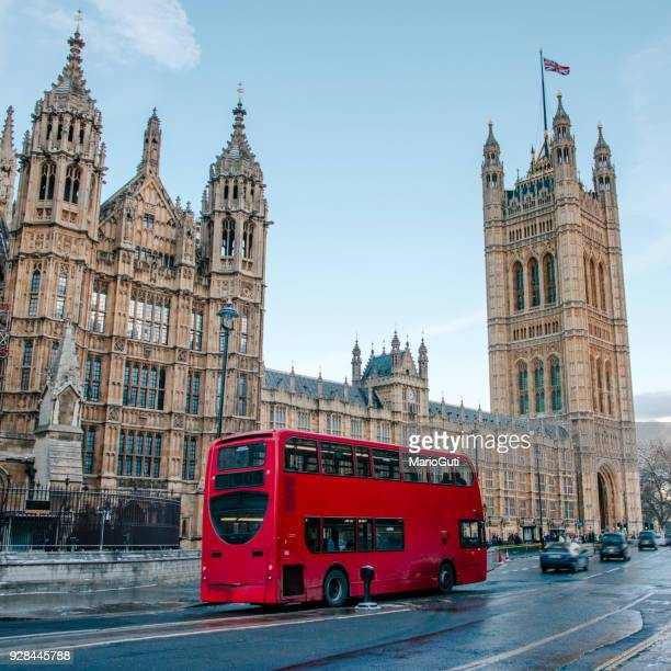 houses of parliament and red double-decker bus - double decker bus stock pictures, royalty-free photos & images