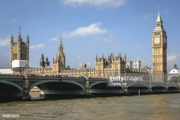 houses of parliament and westminster bridge at noon - westminster bridge stock pictures, royalty-free photos & images