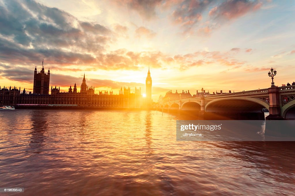 Houses of Parliament and Westminster Bridge at sunset in London : Stock Photo
