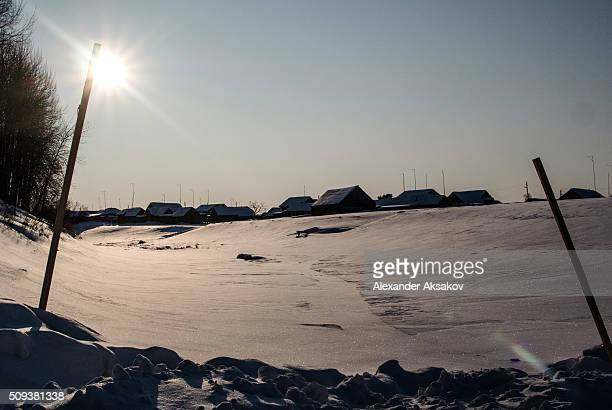 Houses of the village of Topkiny on January 22 2016 in Siberia Russia The only ways to get to Topkiny in summer are a motor boat or a helicopter...
