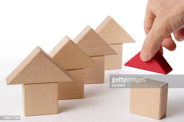 Houses of wood block made by hand on white background