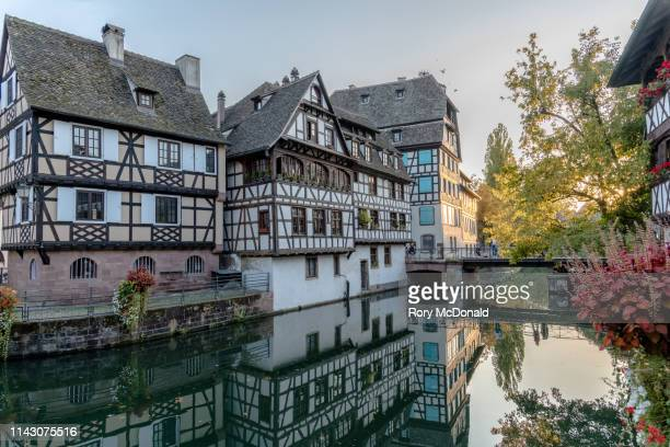 houses on a canal in petite france - strasbourg stock pictures, royalty-free photos & images