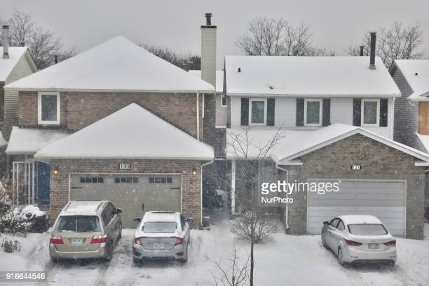 Houses on a residential street pictured during a snowfall which left 10 centimeters of snow in Toronto, Ontario, Canada, on February 9, 2018.