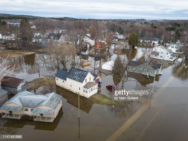 houses on barker's point flooded by the waters of the saint john river, fredericton, new brunswick, canada - 2019 stock pictures, royalty-free photos & images