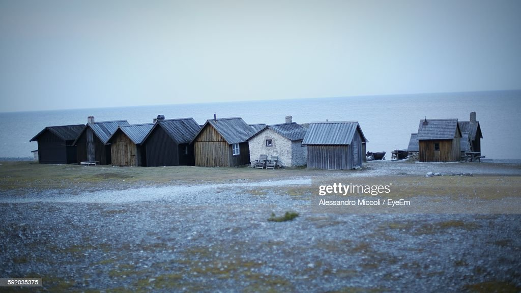 Houses On Beach Against Clear Sky At Dusk : Stock Photo