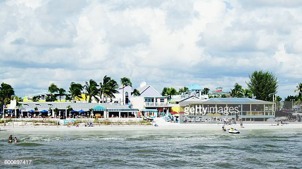 houses on beach against sky - fort myers beach stock pictures, royalty-free photos & images