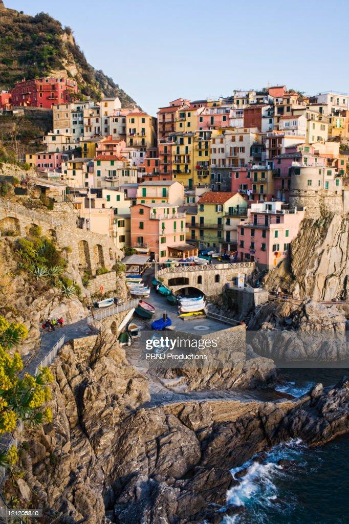 Houses on cliff face near ocean : Stock Photo