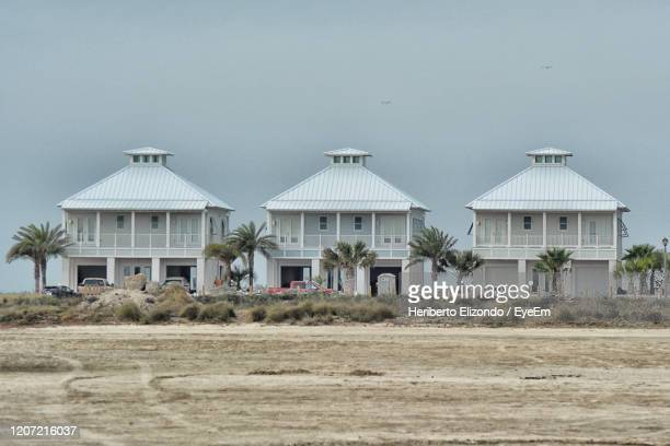 houses on field against clear sky - south padre island stock pictures, royalty-free photos & images