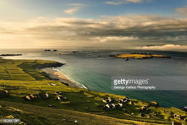 houses on grassy rural hillside - great blasket island stock pictures, royalty-free photos & images