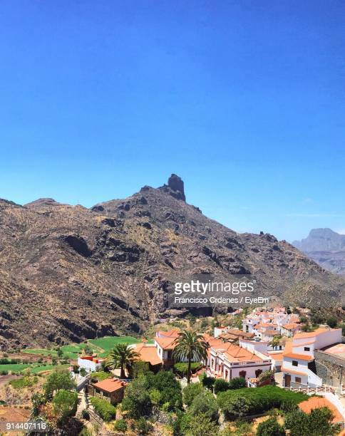 houses on mountain against clear blue sky - tejeda canary islands stock pictures, royalty-free photos & images