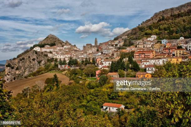houses on mountain against sky - basilicata region stock pictures, royalty-free photos & images