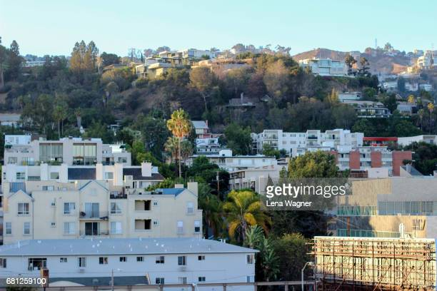 houses on mountain side during sunset - hollywood hills stock pictures, royalty-free photos & images