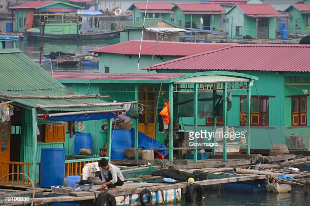 Houses on stilts in a village, Halong Bay, Vietnam
