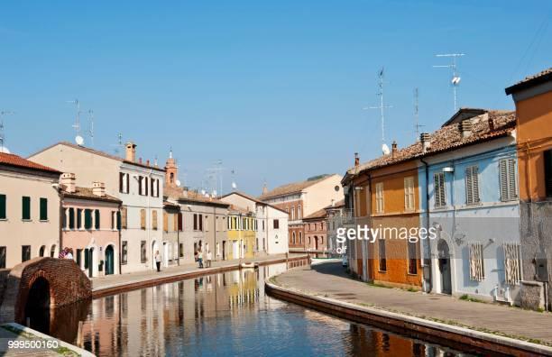 Houses on the canal, Via Agatopisto, Ponte dei Sisti on the left, Comacchio, Ferrara, Emilia Romagna, Italy