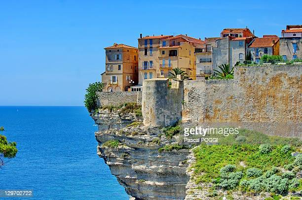Houses on top of cliff