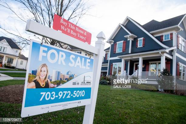 House's real estate for sale sign is seen in front of a home in Arlington, Virginia, November 19, 2020. - The US real estate market is booming even...