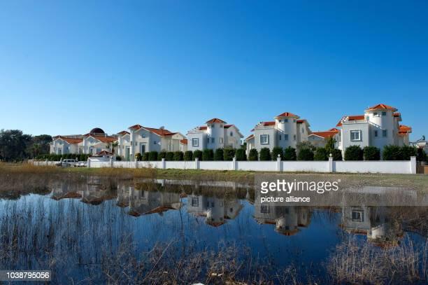 Houses reflect on the water in Belek Turkey 17 January 2015 Photo Soeren Stache/dpa | usage worldwide