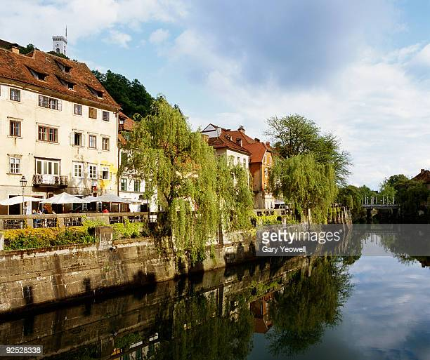 houses reflected by river in ljubljana - yeowell stock pictures, royalty-free photos & images