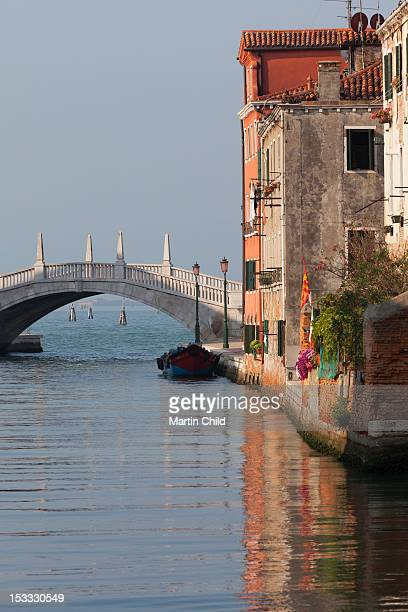 houses reflected in still canal - venetian arsenal stock pictures, royalty-free photos & images