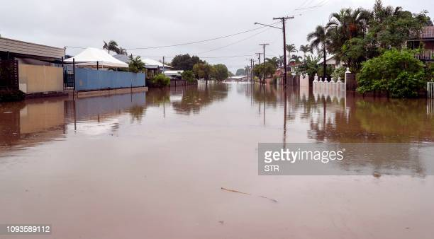 Houses sit in Townsville's floodwaters on February 4 as the recent downpour in Australia's tropical north has seen some areas get a year's worth of...