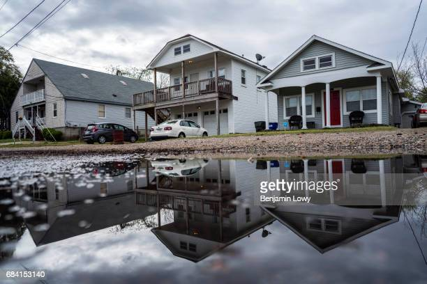 Houses some raised by FEMA while another a non qualifying student rental sits at flood plane level on 51st Street west of Colley Avenue in Norfolk