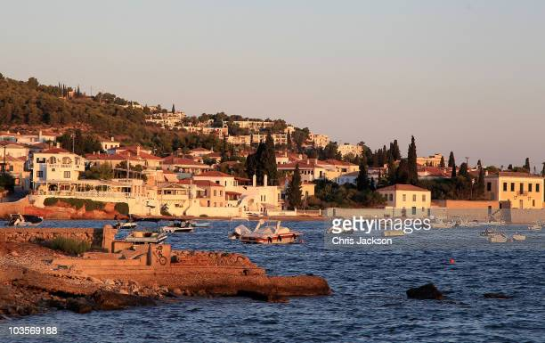 Houses stand along the coastline in the morning light on the island of Spetses on August 24 2010 in Spetses Greece The small Greek Island three hours...