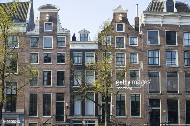 Houses stand beside the Keizersgracht canal in Amsterdam Netherlands on Friday April 20 2018 Brexit will lead as many as 30 significant financial...
