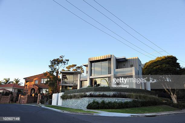 Houses stand in Kew, an eastern suburb of Melbourne, Australia, on Monday, June 28, 2010. A shortage of 200,000 homes in Australia is helping fuel a...