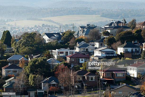 Houses stand in Launceston Tasmania Australia on Tuesday May 31 2016 Tasmanianbranded exports to China have soared 37 percent since a 2014 visit to...