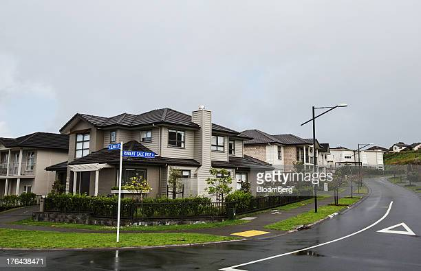 Houses stand in the suburb of Mount Wellington in Auckland New Zealand on Monday Aug 12 2013 New Zealand's growth rate is forecast to outpace...