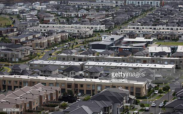 Houses stand in the suburb of Mount Wellington in Auckland New Zealand on Monday July 20 2015 The Reserve Bank of New Zealand meets Thursday and...