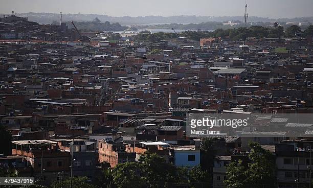 Houses stand in the unpacified Complexo da Mare slum complex one of the largest 'favela' complexes in Rio on March 18 2014 in Rio de Janeiro Brazil...