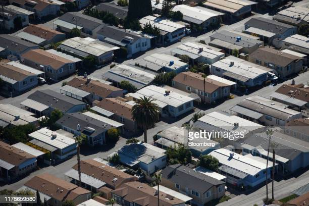 Houses stand in this aerial photograph taken near Mountain View, California, U.S., on Wednesday, Oct. 23, 2019. Facebook Inc. Is following other tech...