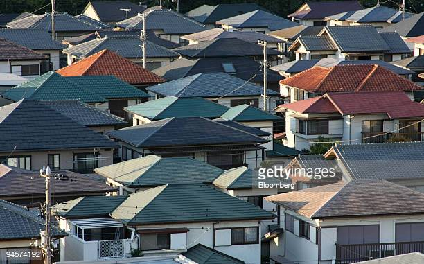 Houses stand in Urayasu City near Tokyo Japan on Sunday Oct 28 2007 Japan's housing starts fell in September for a third consecutive month as changes...