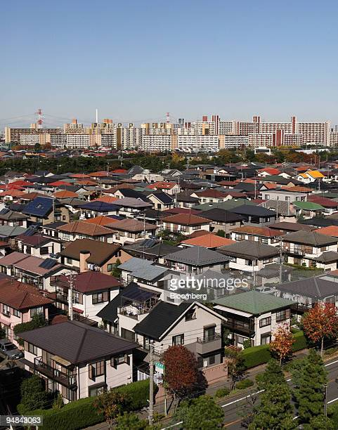 Houses stand in Urayasu City near Tokyo Japan on Thursday Nov 20 2008 Japan's economy will probably shrink this year and next in the first backtoback...