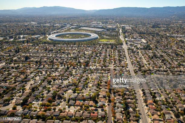 Houses stand near the Apple Inc. Campus in this aerial photograph taken above Cupertino, California, U.S., on Wednesday, Oct. 23, 2019. Apple Inc....