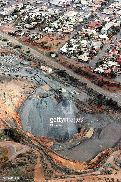 Houses stand near the Fimiston Open Pit mine known as the Super Pit in this aerial photograph taken above Kalgoorlie Australia on Monday Aug 3 2015...