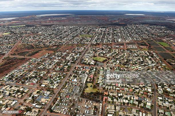 Houses stand near the Fimiston Open Pit mine known as the Super Pit rear in this aerial photograph taken above Kalgoorlie Australia on Monday Aug 3...