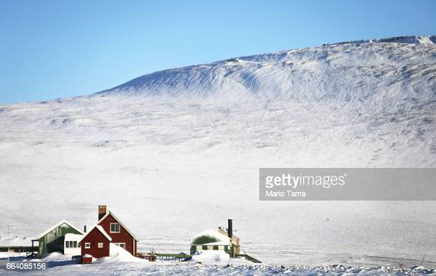 Houses stand near Thule Air Base on March 25 2017 in Pituffik Greenland NASA's Operation IceBridge is flying research missions out of Thule Air Base...