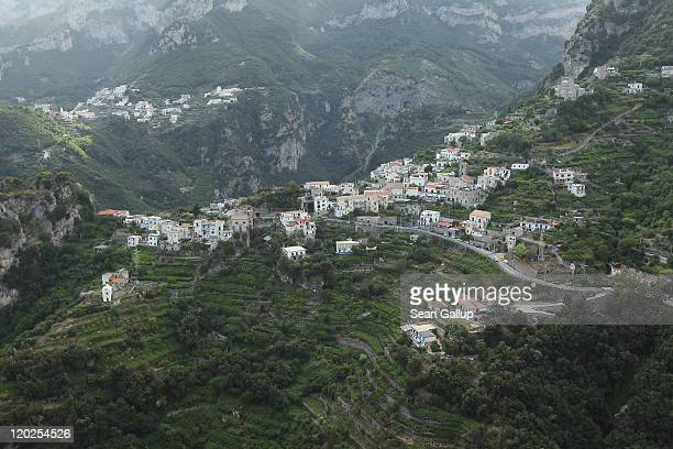 Houses stand perched on a hillside on July 26 2011 in Ravello Italy The Amalfi coastline is among Italy's most popular tourist destinations