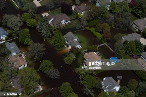 Houses surrounded by flood water are seen in this aerial photorgraph taken after dams failed in Midland Michigan US on Wednesday May 20 2020...