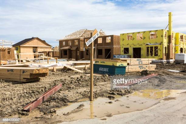 Houses under construction stand in Brampton Ontario Canada on Saturday May 20 2017 After a double whammy of government intervention and the...