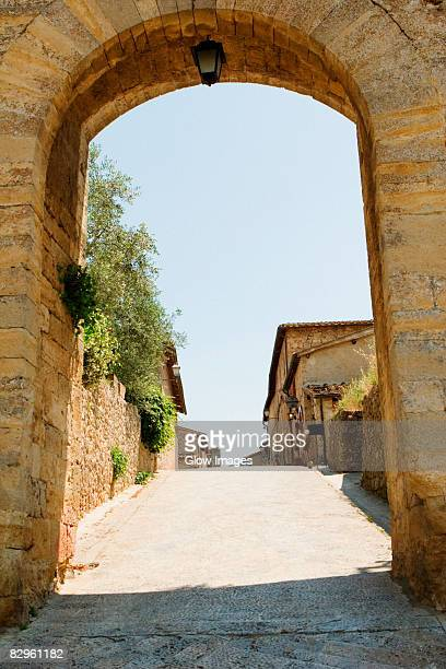 Houses viewed through an archway, Porta Franca, Monteriggioni, Siena Province, Tuscany, Italy