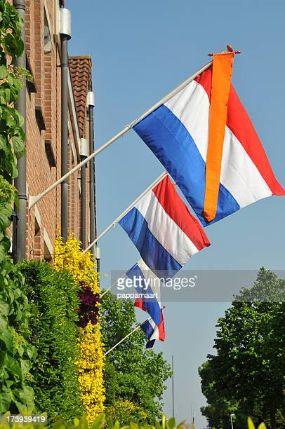 Houses with Dutch flags and orange vanes (pennants)outdoors