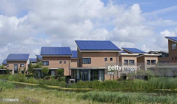 Houses with solar panels on roof