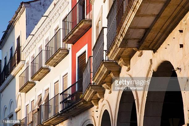 Houses with wrought-iron balconies overlooking Plaza Mayor.