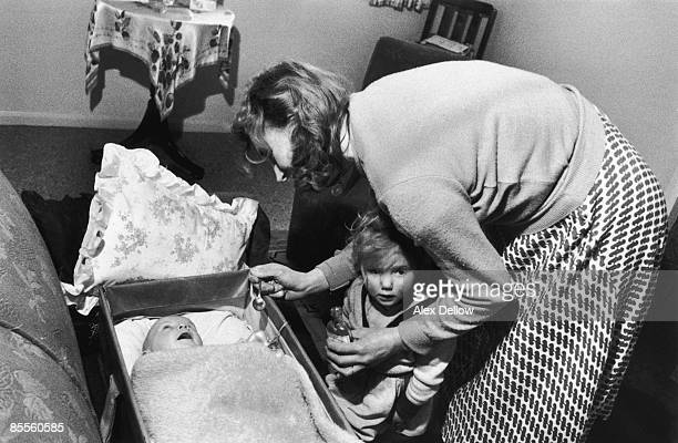 Housewife Annie Driver of Norfolk gives a spoonful of codliver oil to one of her children 10th March 1956 Original publication Picture Post 8285...