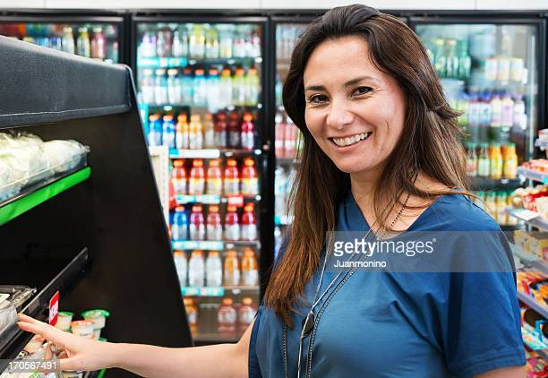 housewife at the supermarket - convenience store stock photos and pictures